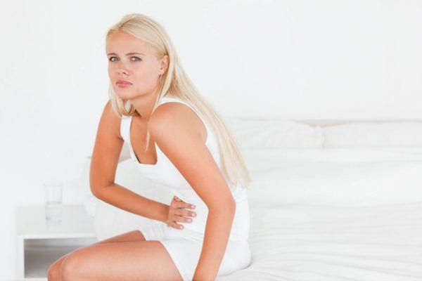 Боли в области пупка у женщин